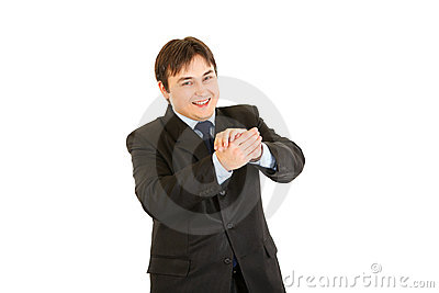 Smiling young businessman cheerfully applauding