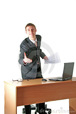Smiling young businessman greeting, workplace