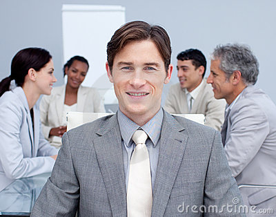 Smiling young businessman in a meeting
