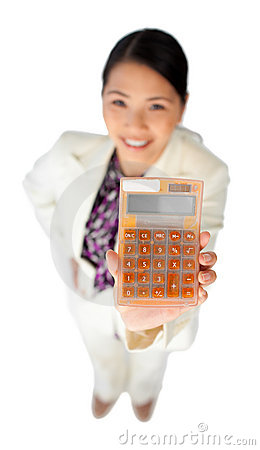 Smiling young businesswoman holding a calculator