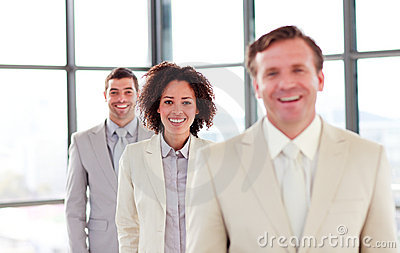 Smiling young businesswoman in a line