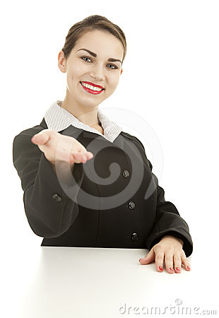 Smiling young businesswoman showing something
