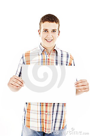 Smiling young casual man holding white sign