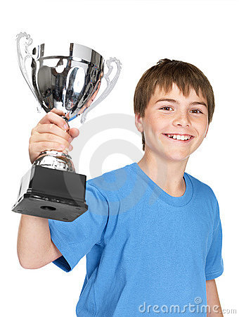 Smiling young champion with his trophy