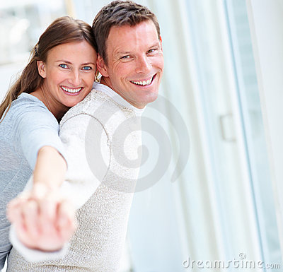 Smiling young couple enjoying together