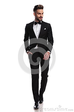 Free Smiling Young Elegant Man Is Walking And Looks To Side Royalty Free Stock Photos - 109721478