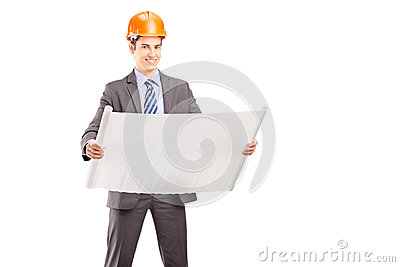 Smiling young engineer posing with a blueprint