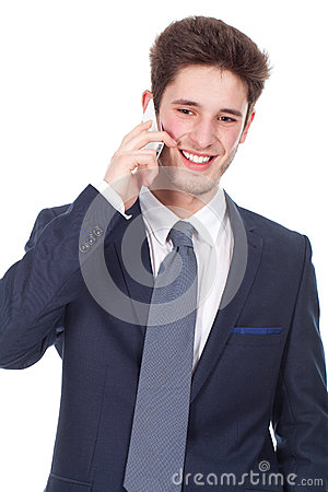 Smiling young executive using cellphone