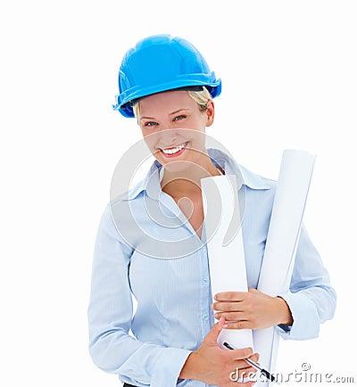 Smiling young female architect holding blueprints