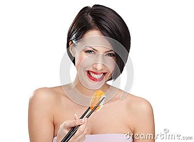 Smiling young female holding sushi