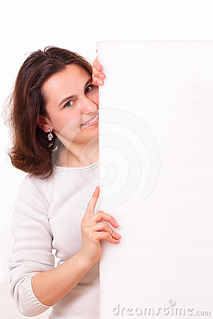 Smiling young girl with a big piece of paper