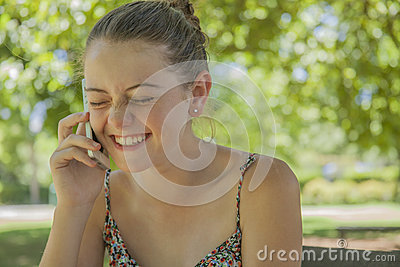 Smiling young girl calling on a cell phone