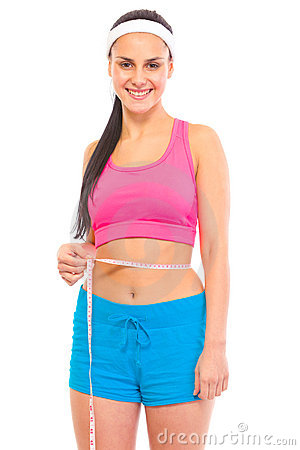 Smiling young girl measuring her waist