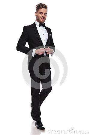 Free Smiling Young Groom Buttoning His Tuxedo Royalty Free Stock Image - 130112546