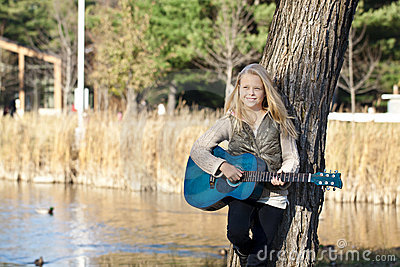 Smiling young guitar player