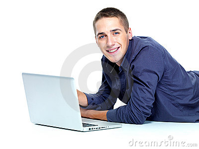 Smiling young guy with laptop