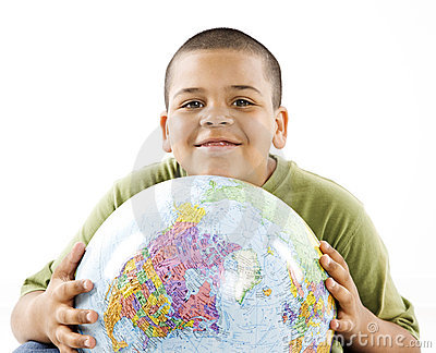 Smiling young hispanic boy with globe
