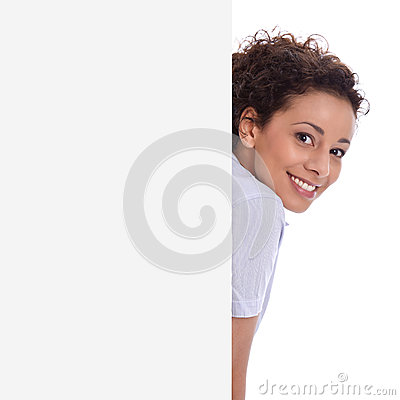 Smiling young isolated business woman makes promotion on a sign