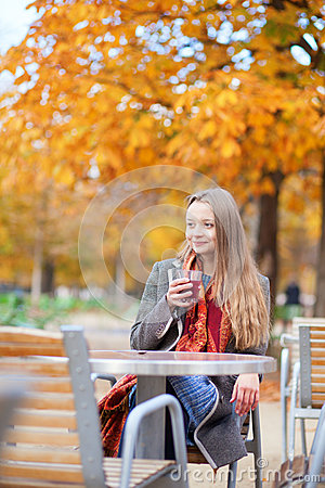 Free Smiling Young Lady Drinking Mulled Wine Royalty Free Stock Photography - 27624817