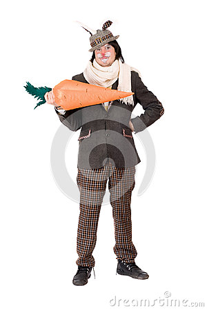Smiling young man with carrot