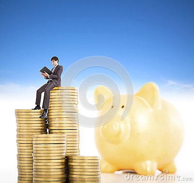 Smiling young man counting coin in piggy bank