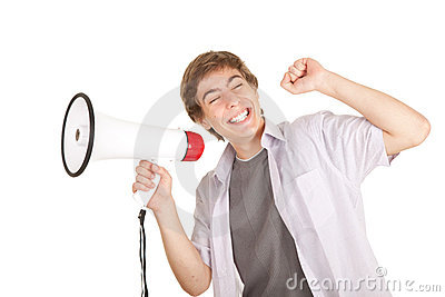Smiling young man holding megaphone
