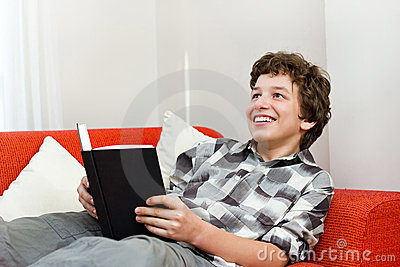 Smiling Young Man Loves to Read for Fun