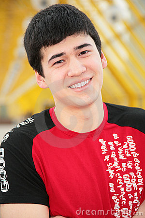 Free Smiling Young Man On Footbridge Royalty Free Stock Images - 5451809