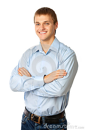 Smiling young man standing with his arms folded