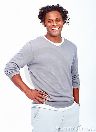 Smiling young man standing isolated on white