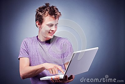 Smiling young man using laptop