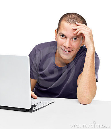 Smiling young man using laptop against white