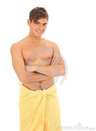 Smiling young man in yellow towel