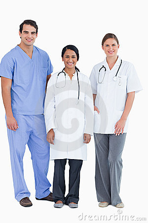 Smiling young medical staff standing together