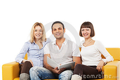 Smiling young people sitting together