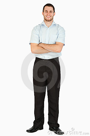 Smiling young post employee with arms folded