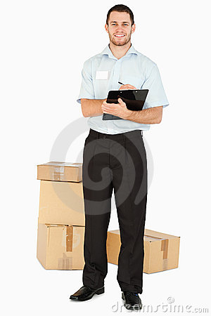 Smiling young post employee with parcels