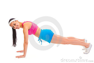 Smiling young sportsgirl doing push-up isolated