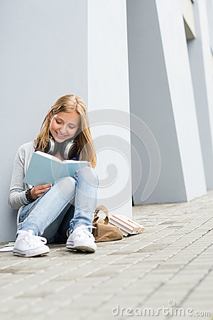 Smiling young study woman read book outdoor