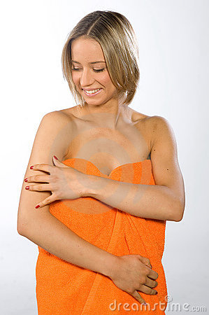 Smiling young woman checking her skin