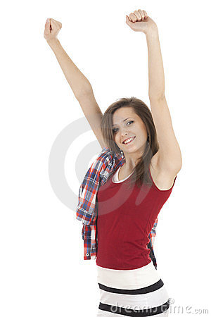 Smiling young woman clenching fists