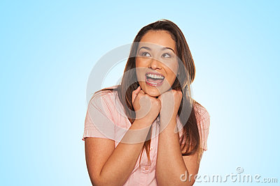 Smiling young woman expressing scare and surprise