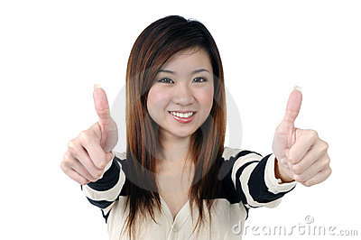 Smiling young woman giving thumbs up sign