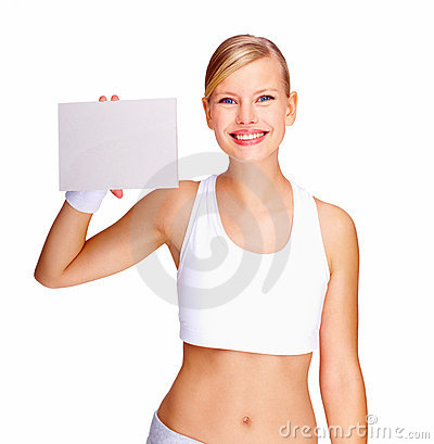 Smiling young woman holding blank billboard