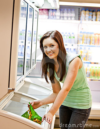 Smiling young woman holding a deep-frozen product