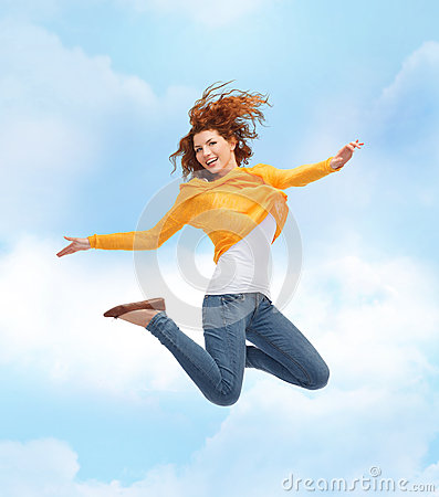 Free Smiling Young Woman Jumping High In Air Royalty Free Stock Image - 46930996