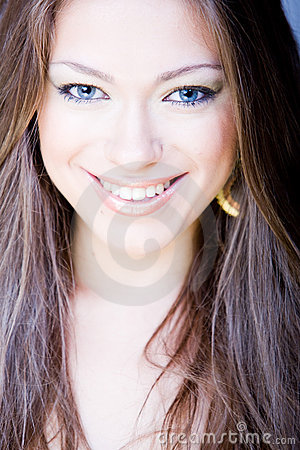 Smiling young woman with long straight hair