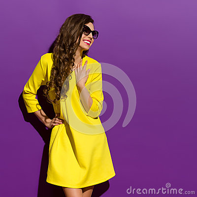 Free Smiling Young Woman On A Violet Background Royalty Free Stock Photography - 55034457
