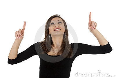 Smiling young woman pointing up Stock Photo