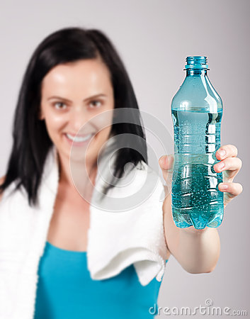 Smiling young woman promoting water